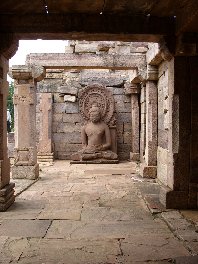 A sitting Buddha statue inside one of the temples