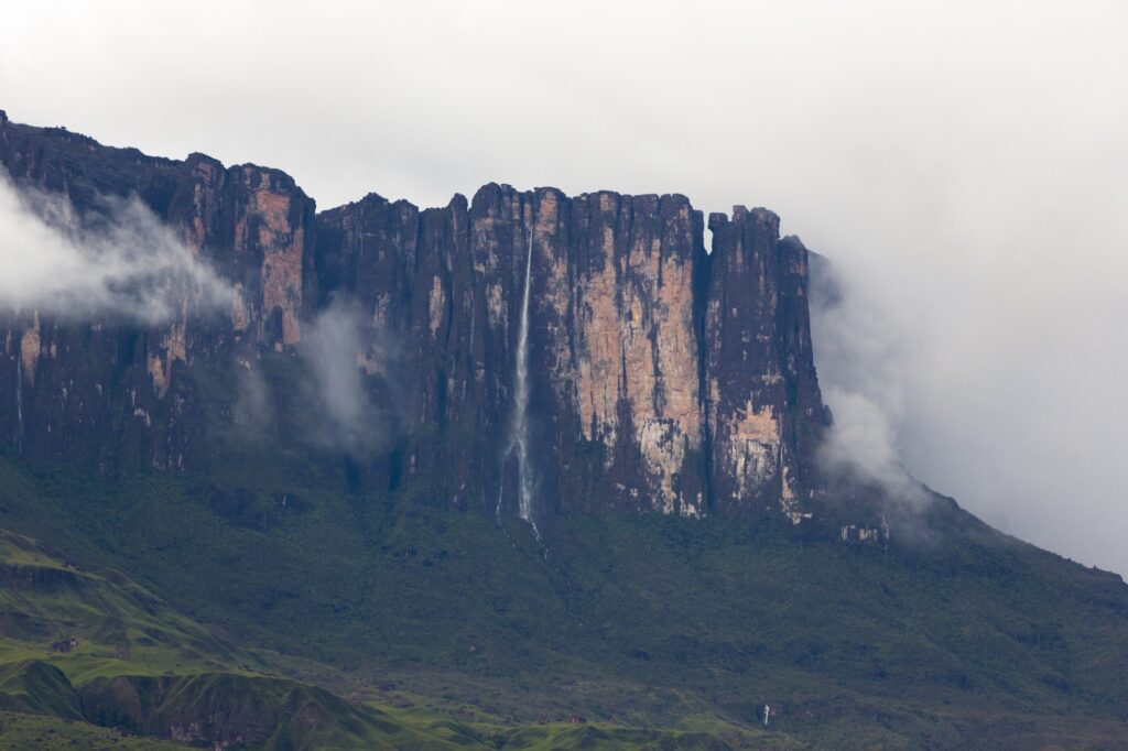 Waterfalls and clouds at Kukenan tepui or Mount Roraima. Venezue